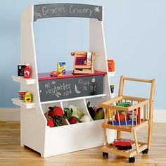 "Adorable play market from Land of Nod! Love the chalkboard signs to feature ""Daily Specials"". :-)"