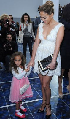Jennifer Lopez's daughter, Emme, is a fashionista in training.  The 4-year-old girl accompanied her mother to the Chanel show at Paris Fashion Week on Tuesday.