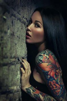 Colorful flower tattoo on ladies arm