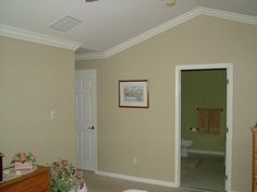 Crown molding on angled/vaulted ceilings. Now I want this in my house.  :o)