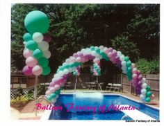 Arches & floating balloon columns really add pizazz to this pool party.