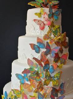 Bringing a textural, fluid look to our gift box design was inspired by multiple images including this tiered cake embellished with layers of multicolored butterflies