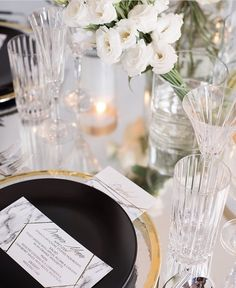 Gold, black, and white tablescape by Glaze and John