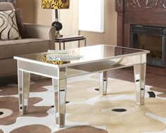 Add a touch of glamour to your living room with this stylish cocktail table. The Mirage Mirrored Cocktail Table is made of MDF and has a mirrored finish. Mirrored Coffee Tables, Coffee Table With Drawers, Coffee Table Furniture, Table Desk, Living Room Furniture, Dining Table, Mirrored Table, Console Table, Living Rooms