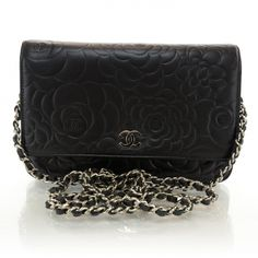 This is an authentic CHANEL Lambskin Camellia Wallet on Chain WOC in Black NEW.   This stylish clutch wallet is finely crafted of camellia embossed lambskin leather.