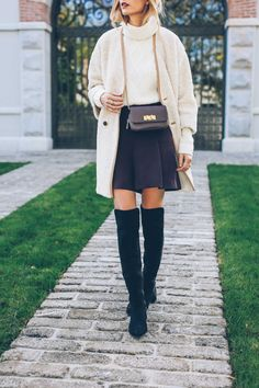 These over the knee boots are to die for, the look super cute with this black skater skirt and that turtleneck sweater is so pretty