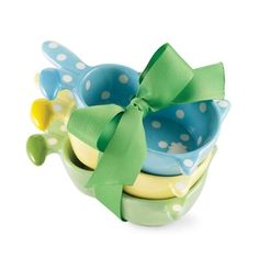 Perfect for the Easter holiday or just for making snack time plain fun, these cutesy, ceramic bunny bowls will have baby eating every bite! This set includes 3 hand painted bowls in blue, yellow and green accented with polka dots. Bowls arrive stacked and tied in grosgrain ribbon and ready for gift giving.