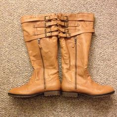 Cognac, Leather Boots Knee-High, partial zipper on outside facing side, full zipper on inside of boot. Four decorative buckles at top of boot. Cognac colored leather, man-made sole. Steve Madden Shoes