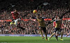 Manchester United 3 Arsenal 2 : Marcus Rashford scores again! His neat header beats Petr Cech in the Arsenal goal.