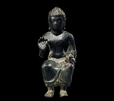 Enthroned Buddha Preaching, second half of the 6th century. Central Thailand. Lent by Jeff Soref | This miniature icon of the Buddha seated in bhadrasana and expounding the dharma is among the earliest known renderings of the subject from the Mon territories. #LostKingdoms