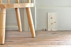 Add tiny dollhouse doors to your skirting boards at home to create the impression of fairies or pixies living in your house - kids are awestruck when they discovered these!