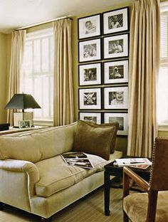 Pictures can be done as corner art once the entertainment center is gone.  Then what about the main wall?