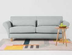 The Orla 3 Seater Sofa in Frost Green Cotton. Combine with the Merida Rug and Range Side Table in Solid Oak and Copper. £699 | MADE.COM