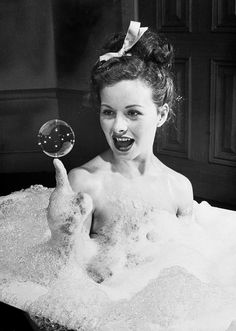 Jeanne Crain takes a bubble bath for LIFE magazine, 1946