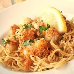 Baked scallops dipped in butter and rolled in ritz cracker crumbs with angel hair pasta -mix in butter and Parmesan cheese!