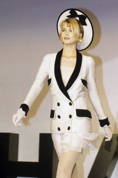 The New Age Working Woman Bride, Spring 1990 - Lagerfeld presented this playful twist on the house's signature bouclé jacket, pairing it with an ethereal mini. The only thing to make it better? A proper topper sitting on supermodel Claudia Schiffer.