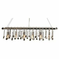 """Crystal chandelier.  Product: ChandelierConstruction Material: CrystalColor: ClearDimensions: 6"""" H x 6"""" W x 52"""" D"""