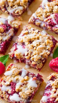 These Raspberry Streusel Bars are loved by everyone and have FOUR layers to love including a buttery shortbread, thick raspberry filling, brown sugar streusel, and vanilla glaze!