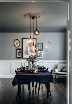 Beautiful dining room with tall panels and dark hardwood floors. We love the pretty Christmas table setting.