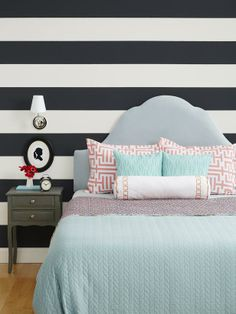 Upgrade a simple headboard by mixing it with a bold wall and pretty duvet cover #hgtvmagazine http://www.hgtv.com/decorating-basics/million-dollar-makeovers/pictures/page-10.html?soc=pinterest