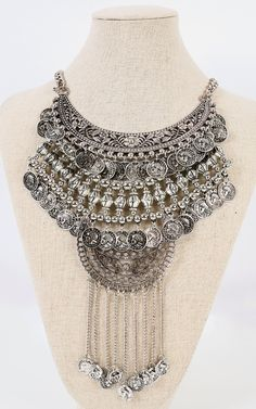 Dare to add a bold tribal accent to your outfit? This floral trim coin bib necklace with rock your boho look! I MakeMeChic.com
