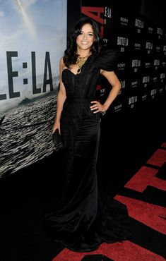 Michelle Rodriguez Studded Clutch - Michelle Rodriguez accented her dramatic black gown with Kelly Locke's Mini Bardot clutch with covered studs in black matte fishskin with gold metallic trim. Studded Clutch, Michelle Rodriguez, Latin Music, Music Awards, Billboard, Celebs, Gowns, Hot, How To Wear