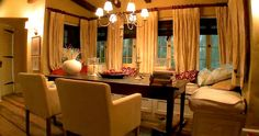 Bella and Edwards Cottage Yellows with red accents. Multiple curtains (not just at the sides) with wood stick blinds.