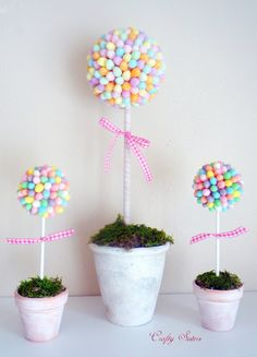 Easter topiary. Just hot glue jelly beans to foam. Easy and cute!