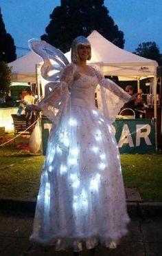 Illumintated Christmas angel on stilts Alan Casey Entertainment Agency