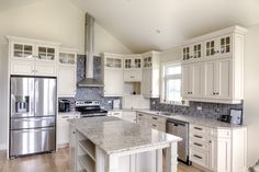 Who doesn't love this kitchen!? Topped with granite countertops and Deslaurier cabinets, this kitchen would be great for hosting and just eating as a family