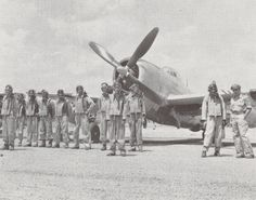 The 201st Mexican Fighter Squadron assembles in front of a P47 Thunderbolt on Porac strip, Clark Field, Luzon.