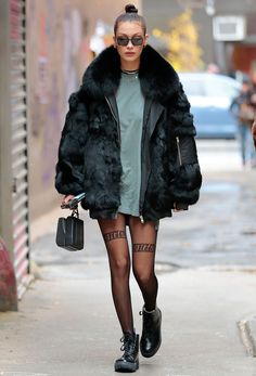 The catwalk queen was spotted out in the Big Apple yesterday braving the cold temps in barely-there tights and a T-shirt. See her outfit here.