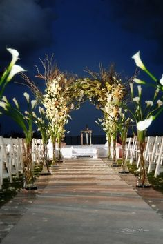 Extremely beautiful outdoor wedding aisle with white lilies... Wedding picture by DominoArts Photography (www.DominoArts.com)