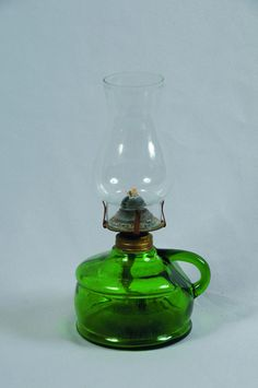 Green glass finger lamp with a glass chimney