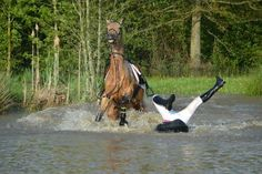 Rider takes a break to do gymnastic shapes in the water