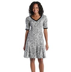 Dresses. Cute and stylish, this fit and flare dress from London Times is perfect for a variety of wearing occasions. Featured in ivory Elbow sleeves V-neck Solid black trim and sleeves and neckline Allover print Back zipper Polyester/rayon/spandex Imported