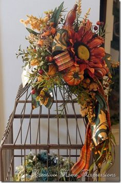 I like how the ribbon is that's under the sunflower~jingelhart Thanksgiving Tree, Thanksgiving Decorations, Fall Decorations, Fall Lanterns, Lanterns Decor, Fall Vignettes, Fall Flower Arrangements, Autumn Crafts, Bird Cages