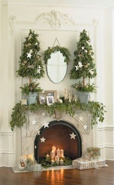 15 Gorgeous Christmas Mantels - Christmas Decorating - stars on the fireplace Christmas Fireplace, Christmas Mantels, Noel Christmas, Christmas Is Coming, Winter Christmas, Christmas Crafts, Faux Fireplace, Fireplaces, White Fireplace