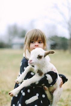 Kid holding a kid goat