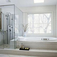 Love this bathroom!  Wouldn't it be great to kick back in that tub and enjoy the view outside?!