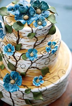 Wood-Like Wedding Cake with Flowers  Three-tiered hand-painted mascarpone-and-white-chocolate butternut cake with gum-paste flowers, Marion Cardwell-Ferrer; Sincredible Pastries.