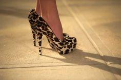 Leopard print platform pumps.