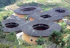 "China: First known ""apartment"" buildings in the world. Tulou translates to ""earthen house"" and are large, generally circular, fortress-like structures."