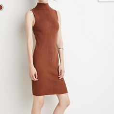 Forever 21 Contemporary Body Con Dress Forever 21 Contemporary ribbed knit body con dress. Sleeveless cut and mock neck. Size XS. Forever 21 Dresses