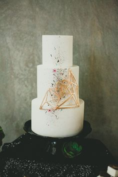 Modern wedding cake with a geometric accent