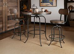 Be the envy of your friends with the Travis 3-piece adjustable-height dining set. This group has an industrial flair with metal frames and rivets bordering the table and stools. The metal is paired with distressed ash hardwood that's attractively presented in a walnut finish. Our favorite thing about this set is how it can go from counter height to bar height with a twist of the table and stools, providing the perfect setting for any get-together.