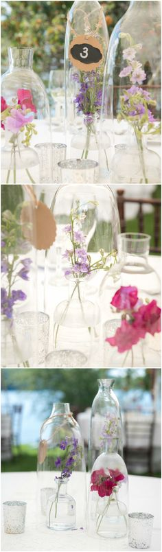 DIY floral centerpieces, delicate purple flowers in glass jars, outdoor wedding reception decor // Kate & Keith Photography