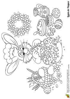 Dessin à colorier de monsieur lapin entrain de confectionner des confiseries pour Pâques