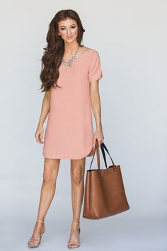 This short sleeve shift dress is the perfect shade of peach and so versatile and easy to wear. We love wearing it to the office, to run errands or for brunch with the girls. Shell: 100% Polyester. Mod