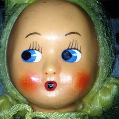 Vintage doll with green herringbone cloth body painted mask face